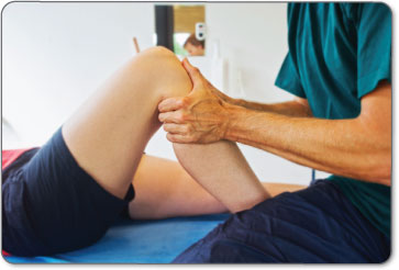 Physical therapists will manually manipulate your leg to perform assisted heel slides while massaging different areas of your leg.